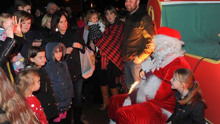Families meet santa at the Man on the Moon pub before the start of the Round Table Rudolph Run aroun