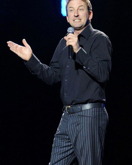 27/03/2006 PA File Photo of Lee Mack performing a stand-up routine during the opening night of the a