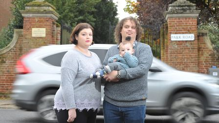 Sophie Davies and Josh Hicks with their son Samuel Earl Davies-Hicks near the fast traffic on Park R