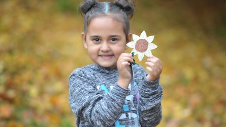 Dejah Robinson with one of her glittery sunflowers Picture: SARAH LUCY BROWN