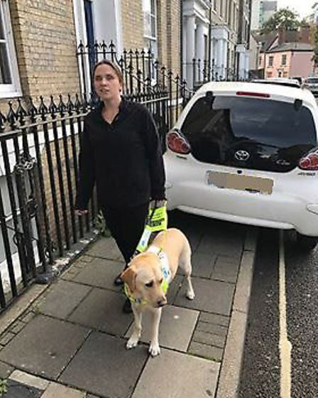 A visually impaired woman had to be guided past cars parked on the pavement in Lower Brook Street, I