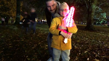 Christchurch Park fireworks display. Father and son Ashley Kennell and Alfie Kennell (aged six), fro