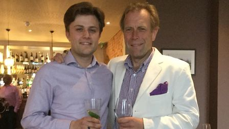 Henry with his father, Stuart Curtis Picture: SUPPLIED BY FAMILY