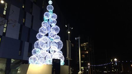 The modern, metal bauble tree now resides on the Waterfront close to the University of Suffolk Pictu