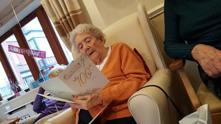 Millie opens some of the many cards she has received Picture: RACHEL EDGE