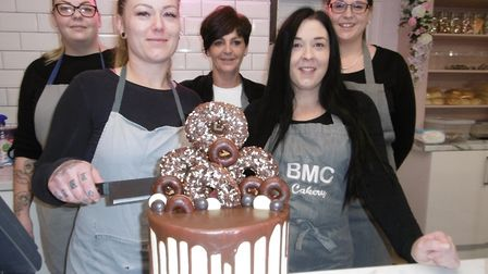 Owner Rachel Halls cuts the cake to open her new BMC Cakery shop in Ipswich Picture: DAVID VINCENT