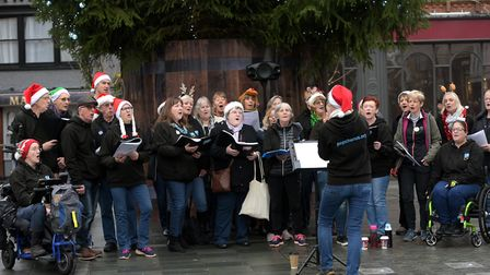 Shoppers were treated to some festive songs by the Pop Chorus , who were rasing money for FIND Pic
