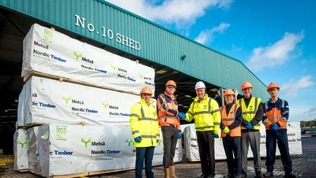 Andy Constable (second left), head of operations at ABP's Port of Ipswich shaking hands with Ian Haw