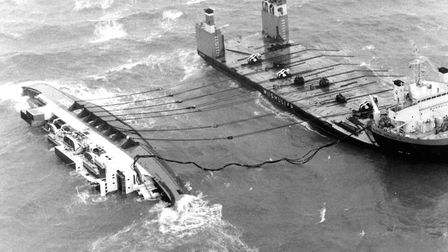 The European Gateway on her side off Felixstowe after the accident in 1982, showing preparations und