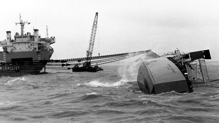 Preparations are made for the first attempt to right the European Gateway after the disaster off Fel