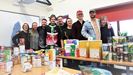 Direct Line workers helped sort the Christmas hampers which Claydon High School pupils donated to Ip