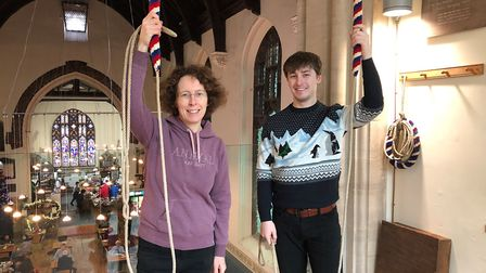Katharine Salter and her son with the bells at St Lawrence Church. Picture: KATHARINE SALTER