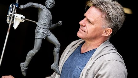 Sean Hedges-Quinn working on the maquette of the Kevin Beattie statue. Picture: SARAH LUCY BROWN