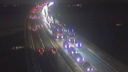 There are long delays over the Orwell Bridge after two vans crashed closing a lane on the A14. Pictu