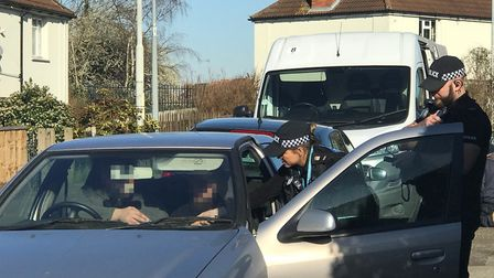 Operation Sentinel's Pc Mina Fernandez and Pc Dan Newson check a driver's documents at the roadside
