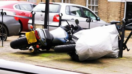 Even motorbikes were blown over on Angel Hill in Bury St Edmunds Picture: TONY HOWLAND