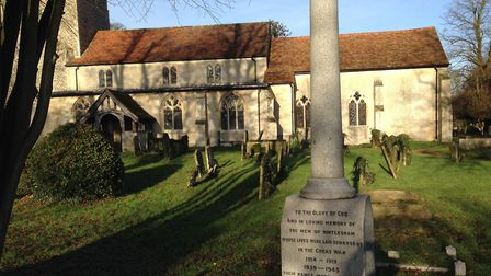 The war memorial at Hintlesham, in the grounds of St Nicholas Church Picture: STEVEN RUSSELL