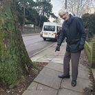 Emin Scotchmer, 77, of Cumberland Tower in Norwich Road points out the raised pavement along Norwich