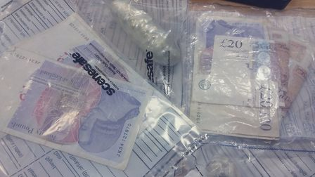 Cash thought to be in the region of £500 seized alongside 50-70 wraps of suspected Class A drugs in