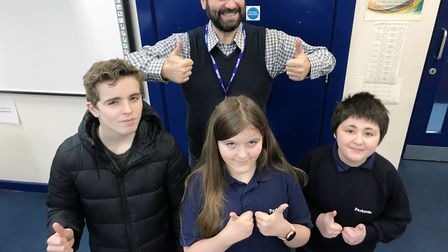 Sign language instructor George Andronic at Parkside Academy in Ipswich with pupils Adam Smith, Oliv