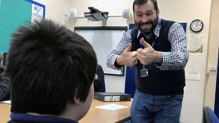 Sign language instructor George Androni teaches a pupil at Parkside Academy in Ipswich. Picture: Lau