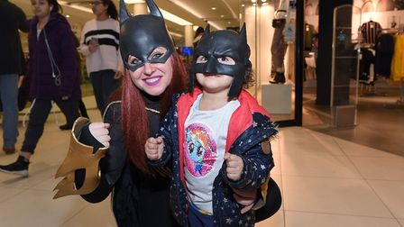 Batgirl gets a hug off little Marley from Ipswich at last year's Hero Quest event. Picture: PAGEPIX