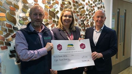 St Elizabeth receives its £8k cheque from Sackers. Pictured from left is Adrian Dodds, Harriett Warr