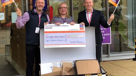 EACH receiving its donation from Sackers, from left, Adrian Dodds, Hannah Bloom and David Dodds Pic