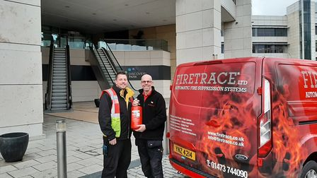 Andy Laws, service manager at Firetrace Ltd, right, with Grant Hutchison, fire safety officer at Dis