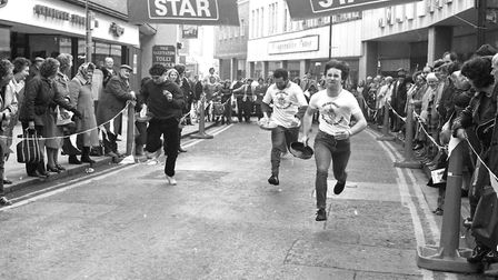 Although in the lead, the runner on the right dropped their pancake on their way Picture: JERRY TURN