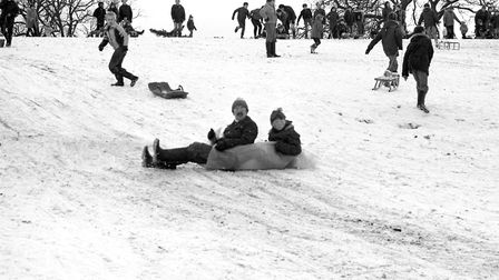 Sledders making their way down the hills in the snow Picture: ARCHANT