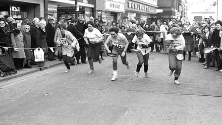 As the pancake race sets off unfortunately one runner drops their pancake from the off Picture: JAM