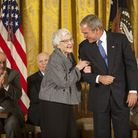 President George W Bush awards the Presidential Medal of Freedom to author Harper Lee in 2007, sayin