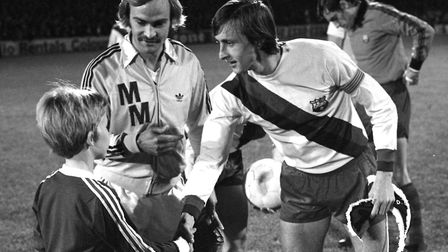 What a treat for the young mascot in 1977 as he shakes the hand of Johann Cruyff, regarded by many a