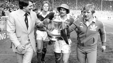Ipswich Town manager Bobby Robson (left) and coach Cyril Lea are escorted by players David Geddis an