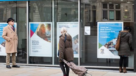 People wait outside the co-operative bank on day seven of lockdown Picture: SARAH LUCY BROWN