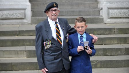 Harold Farrow with his grandson Charlie at a ceremony honouring veterans at Ipswich Cornhill in 2015