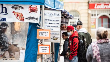 People queue up to get their fish from Youngs market stall Picture: SARAH LUCY BROWN