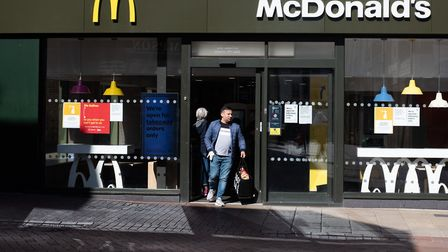 Members of the public grabbing their last Mcdonalds after it was announced they were to close at the