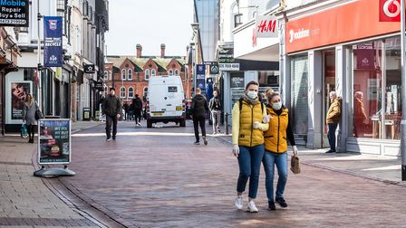 Members of the public wear face masks in Ipswich Picture: SARAH LUCY BROWN