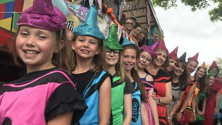 Children and staff from Fairfield infant school and Colneis junior school dressed as colourful crayo