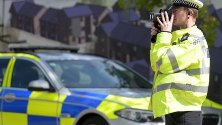 Pc Sid Carr performing a speed check on Bury Road Picture: SARAH LUCY BROWN