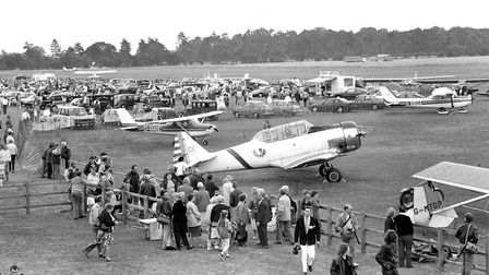 Looking over the collections on show at Ipswich Airport at a car and plane rally in 1989 Picture: I