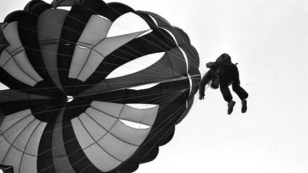 A parachutist coming back down to earth after a trip above the clouds in 1979 Picture: JOHN KERR