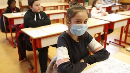 Schoolchildren, some wearing masks, attend a class in Strasbourg, France. Ipswich MP Tom Hunt says s