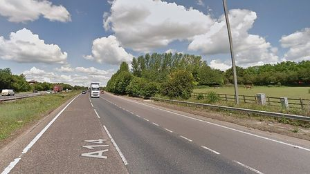 A car has collided with the central reservation on the A14 close to junction 55 at Claydon, blocking