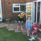Rebecca Fish, Ipswich, ran a marathon in her garden. She is dressed as a bumblebee Picture: Rebe