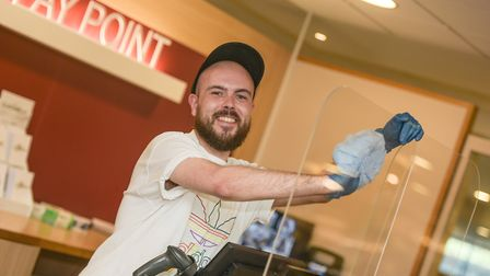 Luke Hayes , Homewares Manager at Glasswells , preparing the new screens at the pay point Picture: