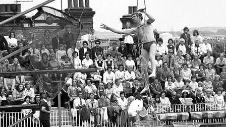 A rope ladder hanging from the diving board for a game of aerial basketball in an It's A Knockout st