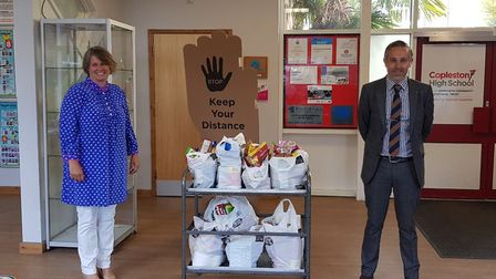 Copleston High School has set up a 'community shelf' scheme with the Raedwald Trust. Pictured are An